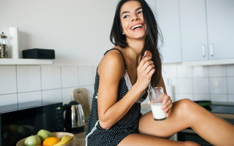 Woman smiling with a glass of milk